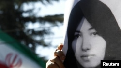 A demonstrator holds a picture of Sakineh Mohammadi Ashtiani at a protest in front of the Iranian Embassy in Rome earlier this month.