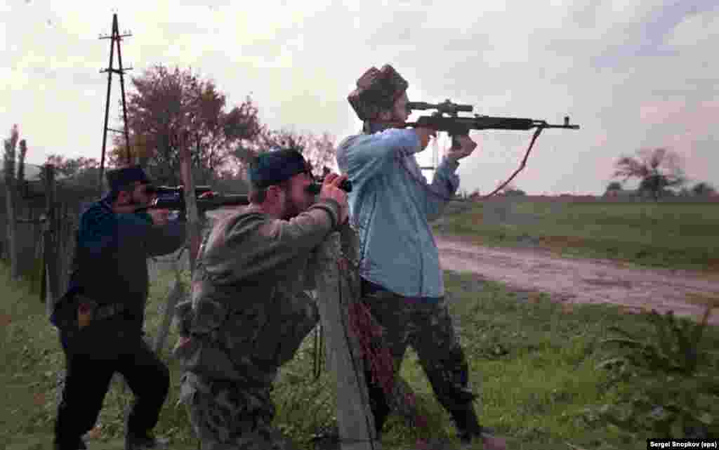 Chechen fighters watch federal troops through their rifle scopes on October 17.