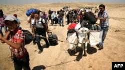Ирактың Күрдістан аймағына босып бара жатқан сириялықтар. 18 тамыз 2013 жыл.