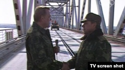 A screen grab from Russia's Channel One shows Mikhail Leshchinsky (left) with Soviet Army General Boris Gromov on February 15, 1989, at the Afghan-Soviet border.