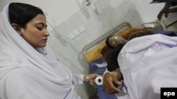 A Pakistani security official receives treatment at a hospital in Peshawar after he was injured in a bomb blast on April 24.