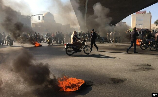 Iranian protesters rally amid burning tires, in the central city of Isfahan on November 16, 2019