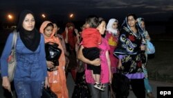 Pakistani students rescued from Osh arrive in Pakistan on June 15.