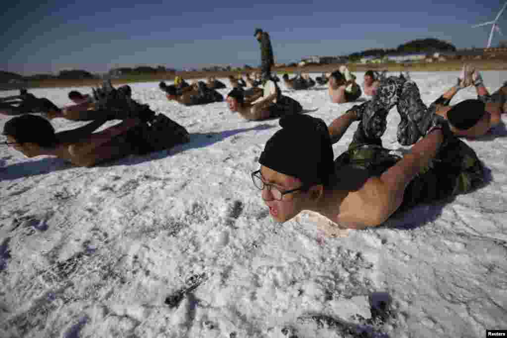 Students attend a winter military camp in Ansan, south of Seoul, South Korea. Hundreds of students between 11 and 17 years old attend winter boot camp training courses every year. The winter courses range from four to 14 days at the Blue Dragon Camp run by retired marines. (Reuters/Kim Hong-Ji)