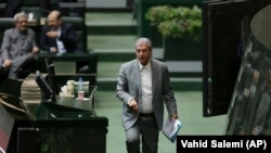 Iranian Labor Minister Ali Rabiei walks to the podium during his parliament impeachment hearing, in Tehran, March 13, 2018