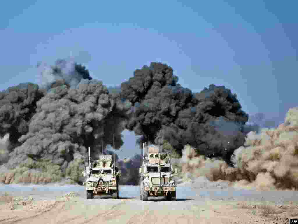 "U.S. soldiers blow up a wall of a compound around Kop Ahmed camp near Kandahar city on November 29. Afghan relations with the United States will not be affected by leaked U.S. criticism of President Hamid Karzai as an ""extremely weak"" and conspiracy-prone leader, his spokesman said. Photo by Martin Bureau for AFP"