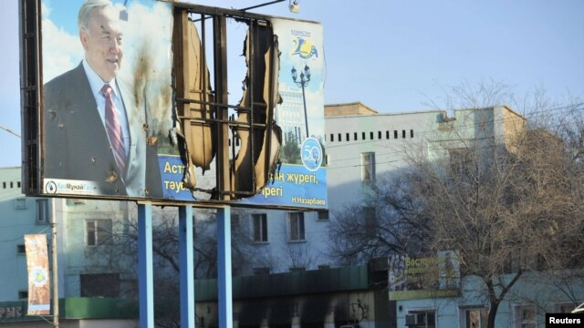 A billboard featuring President Nursultan Nazarbaev was damaged during the violence in the town of Zhanaozen.
