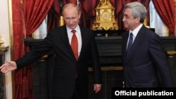 Russian President Vladimir Putin (left) appears to have succeeded in getting his Armenian counterpart Serzh Sarkisian (right) to snub the EU in favor of the Moscow-led Customs Union. (file photo)