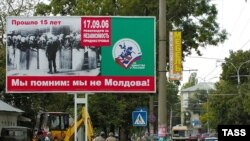 The placard reads 'Remember That We Are Not Moldova' on a Tiraspol street in Transdniester