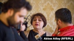 Azerbaijan -- Baku. RFE/RL Journalist Khadija Ismayilova talking to journalists In Baku, 18 February 2014