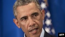 Președintele Obama făcînd o declarație de presă despre moartea jurnalistului american James Foley la reședința de la Martha's Vineyard,20 august 2014.