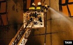 Firefighters battle the warehouse blaze.