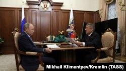 20 декабря 2017. Президент РФ Владимир Путин и президент Татарстана Рустам Минниханов во время встречи в Кремле