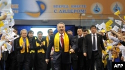President Nursultan Nazarbaev's supporters greet him (center) as he arrives for a celebration rally at a sports center in Astana on April 4.
