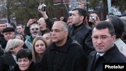 Armenia - Raffi Hovannisian (C), the leader of the opposition Zharangutyun party, looks on as thousands of people pour into Yerevan's Liberty Square, 18Mar2011.