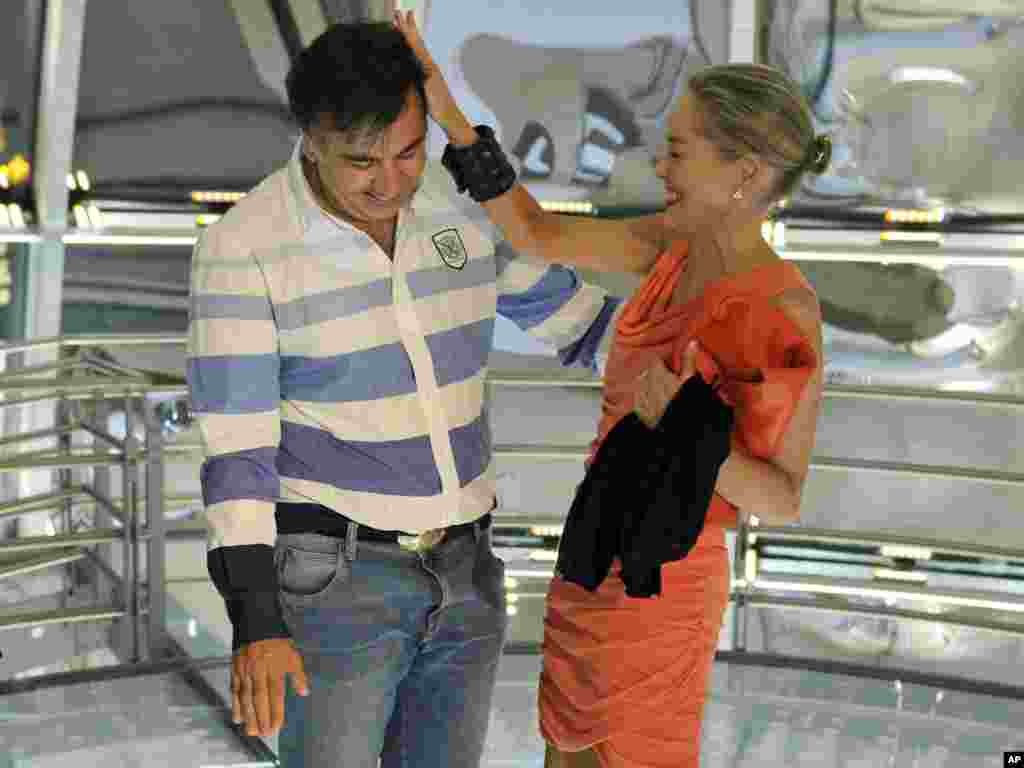 "Georgian President Mikheil Saakashvili welcomes U.S. actress Sharon Stone to the presidential palace in Tbilisi. Stone was in the capital to promote ""5 Days Of August,"" a film about the 2008 war between Russia and Georgia.Photo by Irakli Gedenidze for AP"