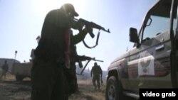 Курдские ополченцы в районе Мосула, Ирак.