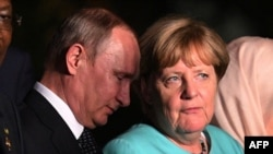 German Chancellor Angela Merkel, seen here at a recent Group of 20 meeting with Russian President Vladimir Putin, said sanctions against Russia over its actions in Syria should remain an option.