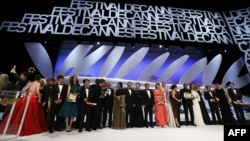 Winners and hosts onstage at the conclusion of the 66th Cannes International Film Festival in May.