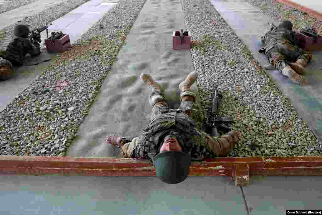 Afghan National Army soldiers take part in a training exercise at the Kabul Military Training Center. (Reuters/Omar Sobhani)