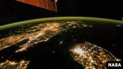 A satellite image shows the Korean Peninsula at night.