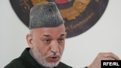 Afghan President Hamid Karzai speaks at the Independent Electoral Commission compound in Kabul on April 1.