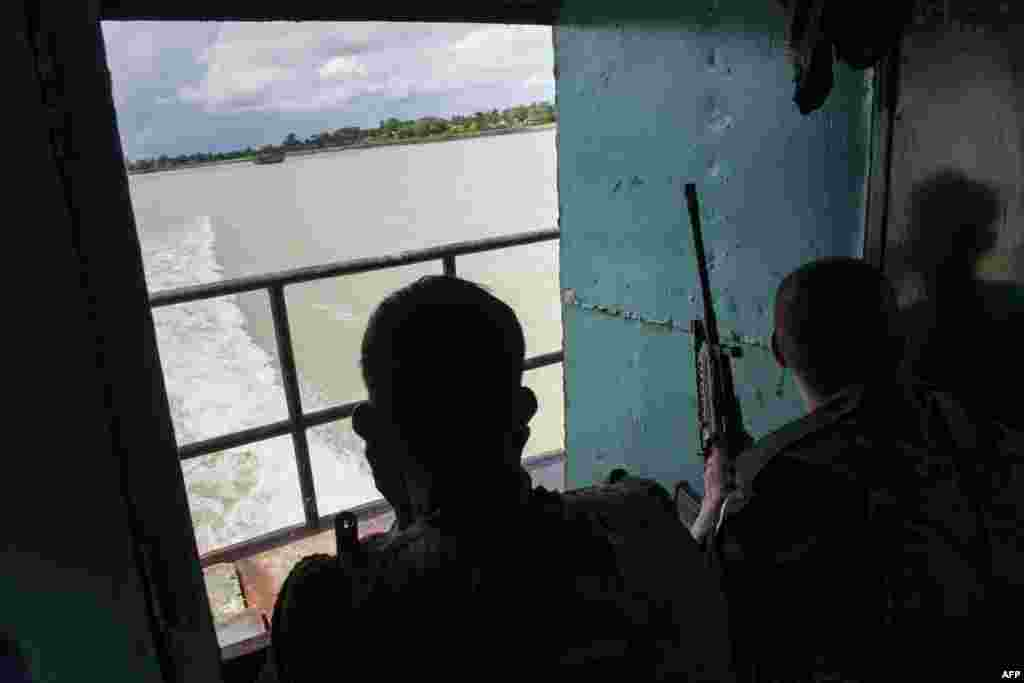 Burmese soldiers travel by boat from Buthidaung to Sittwe in Rakhine State.