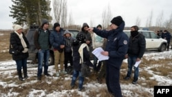 Serbian border police officers detained a group of Afghan asylum seekers as they tried to illegally cross the Serbian-Hungarian in February.