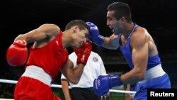 Представитель сборной Узбекистана по боксу 23-летний Шахрам Гиясов (справа) одержал великолепную победу над марокканцем Мухаммедом Рабии.