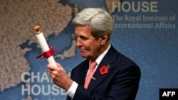 U.K. -- US Secretary of State John Kerry holds a scroll after receiving the Chatham House Prize to recognise his role in negotiating the nuclear deal between Iran and the P5+1 nations at Chatham House in London, October 31, 2016