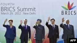 The heads of state of Brazil, Russia, India, China, and South Africa pose prior to their summit in New Delhi on March 29.