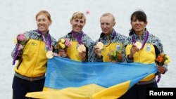 Gold medallists (left to right) Kateryna Tarasenko, Yana Dementieva, Anastasiia Kozhenkova, and Nataliya Dovgodko of Ukraine pose during the victory ceremony after the women's quadruple sculls Final A at Eton Dorney during the London Games on August 1.