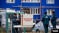Russian police examine outside a court building in the western Siberian city of Kurgan where three grenades were detonated on November 1.