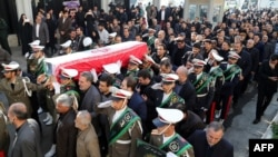 The honor guard carry the coffin of Iran's former ambassador to Lebanon Ghazanfar Roknabadi, who was killed in Saudi Arabia, during a repatriation ceremony upon the arrival of his body at Tehran's Mehrabad Airport on November 27, 2015.