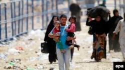 Türkiyə-Suriya sərhədində suriyalı qaçqınlar