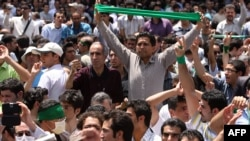 Iranian opposition supporters protest in Tehran after Ahmadinejad's election victory in July 2009.