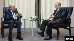 Russian President Vladimir Putin (right) meets with FIFA President Sepp Blatter in Sochi on April 20.