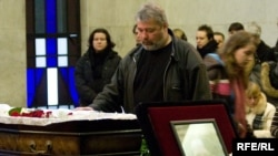 "Dmitry Muratov, editor in chief of ""Novaya gazeta,"" attends the funeral of Anastasia Baburova, one of the newspaper's journalists who was gunned down in January."