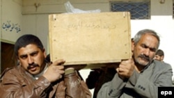 Men carry the coffin of a bomb attack victim during a funeral in Al-Najaf.