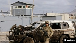AnU.S. soldier arrives at the site of a suicide attack in October.