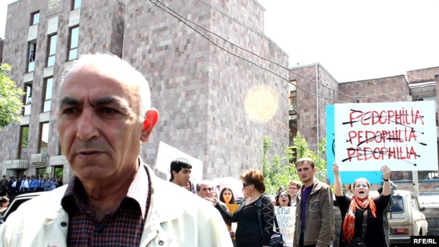 Former school teacher Levon Avagian facing child abuse charges walking away from a protest in Yerevan, 19 May 2010