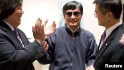 Blind activist Chen Guangcheng shakes hands with US Ambassador to China Gary Locke, in Beijing on May 2.