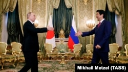Russian President Vladimir Putin (left) meets with Japanese Prime Minister Shinzo Abe at the Kremlin in Moscow on April 27.