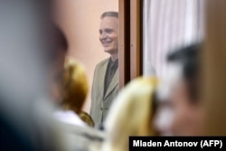 Christensen stands inside the defendants' cage as he awaits the verdict.