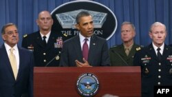 U.S. President Barack Obama (center) announces the new strategy at the Pentagon.