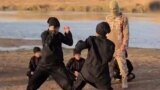 A screengrab from a video purportedly showing young Uyghurs training somewhere in the Middle East and making threats against China. There seems to have been a crackdown on ethnic Uyghurs living in China since the film was released online.