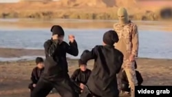 A screengrab from a video purportedly showing Uyghurs training somewhere in the Middle East and making threats against China.