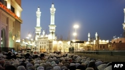 Muslim pilgrims perform the evening prayer near the Grand Mosque in the Saudi holy city of Mecca on November 12.