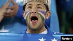 Qatar -- An Uzbek fan shouts before their 2011 Asian Cup semi-final soccer match against Australia at Khalifa stadium in Doha, 25Jan2011