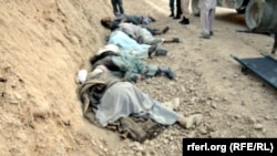 Corpses of some of the 14 passengers killed in the western Afghan province of Ghor on 25 July 2014.